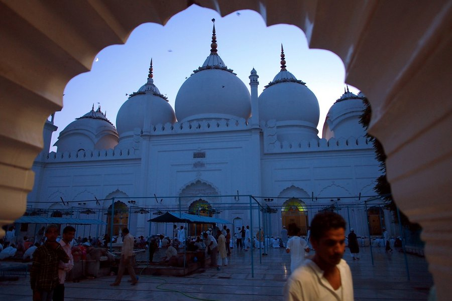 The Upper Court City mosque in Aligarh, India, near sundown, with faithfuls milling around.