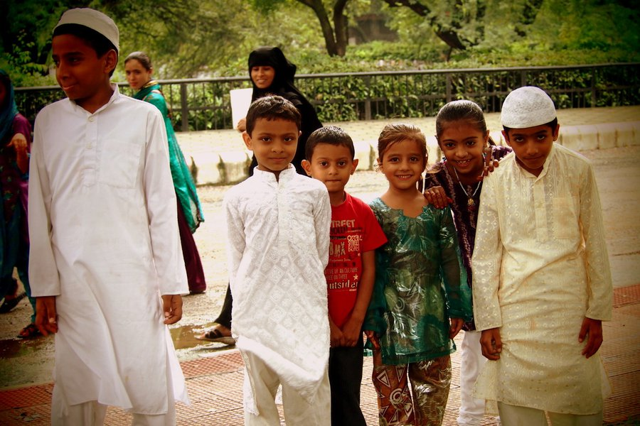 Muslim kids visiting Humayan's Tomb monument in New Delhi, India.