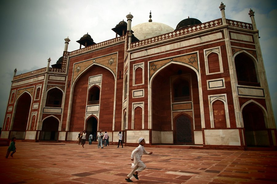 Breaking away at Humayun's Tomb, New Delhi, India.