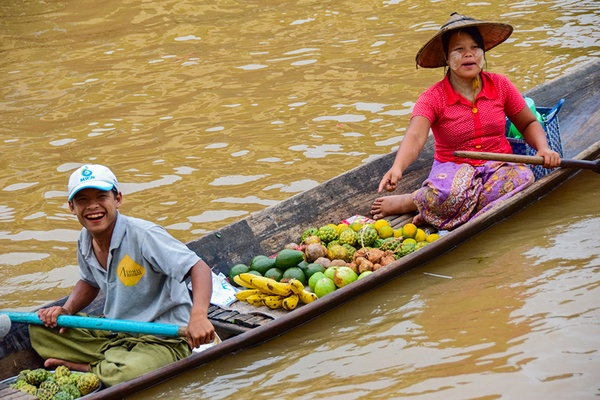 Locals smiling in a boat