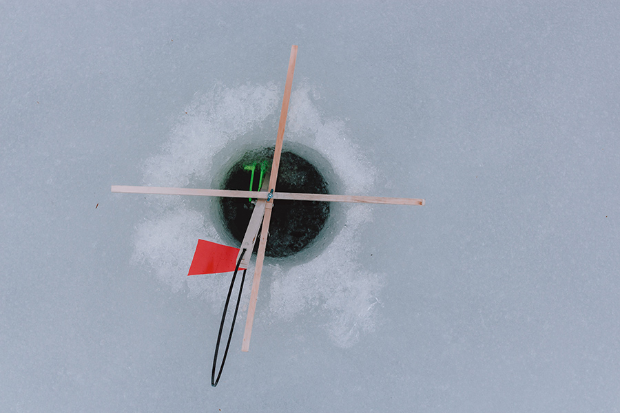 Fathom ice fishing as a boozy nyc weekend alternative for Ice fishing hole