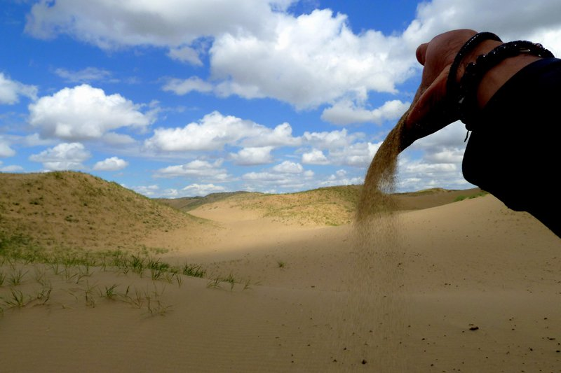 Ashes to ashes, dust to dust. In remote eastern desert dunes of eastern Mongolia.