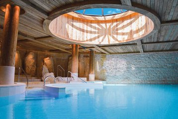 The swimming pool at Six Senses Spa Alpina Gstaad.