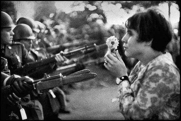 A girl confronting the American National Guard outside the Pentagon during the 1967 anti-vietnam march