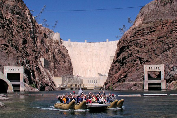 See the Hoover Dam from a pontoon boat. Photo: Courtesy of Pink Jeep Tours.