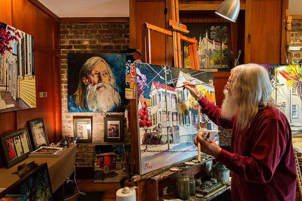 An artist paints at The Vendue.