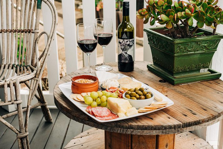 Table with wine and cheese.