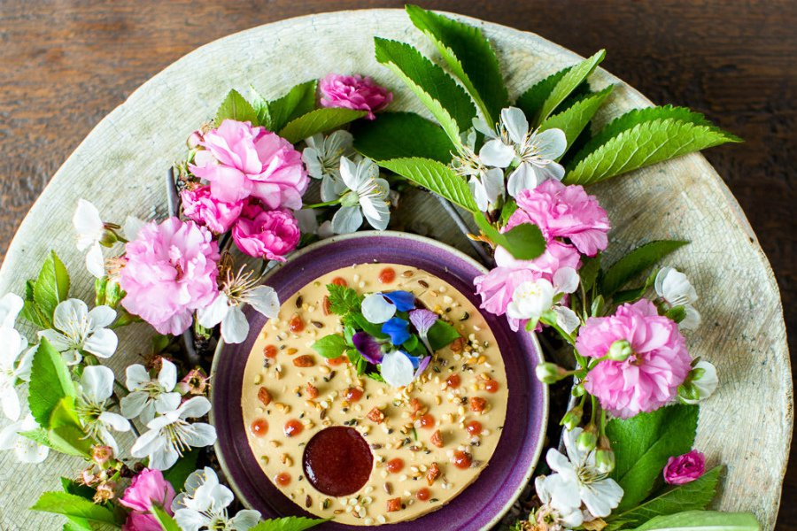 A dish at SingleThread Restaurant, featuring flowers and fresh greens