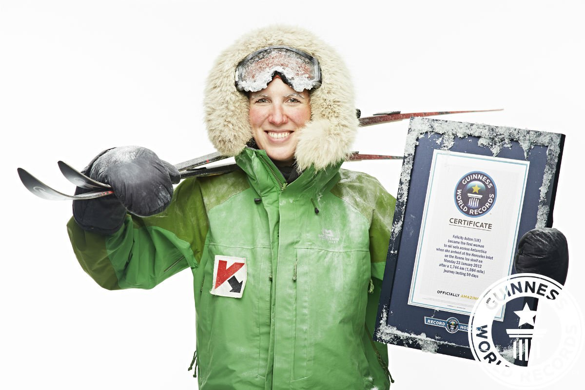 Felicity Aston holding her Guinness World Record award.