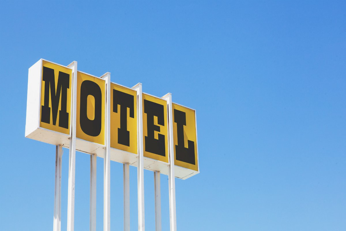A motel road sign beckons travelers to The Skyview