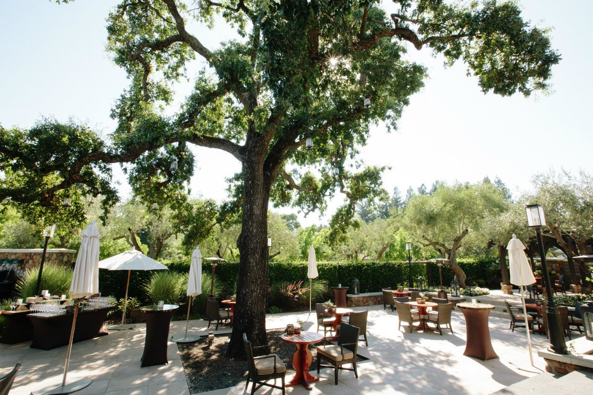 Outdoor seating on the patio of Hotel Yountville