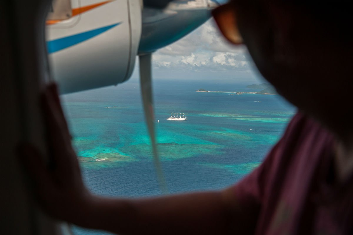 The bluest of blues in the Grenadines, as seen from a tiny plane window.