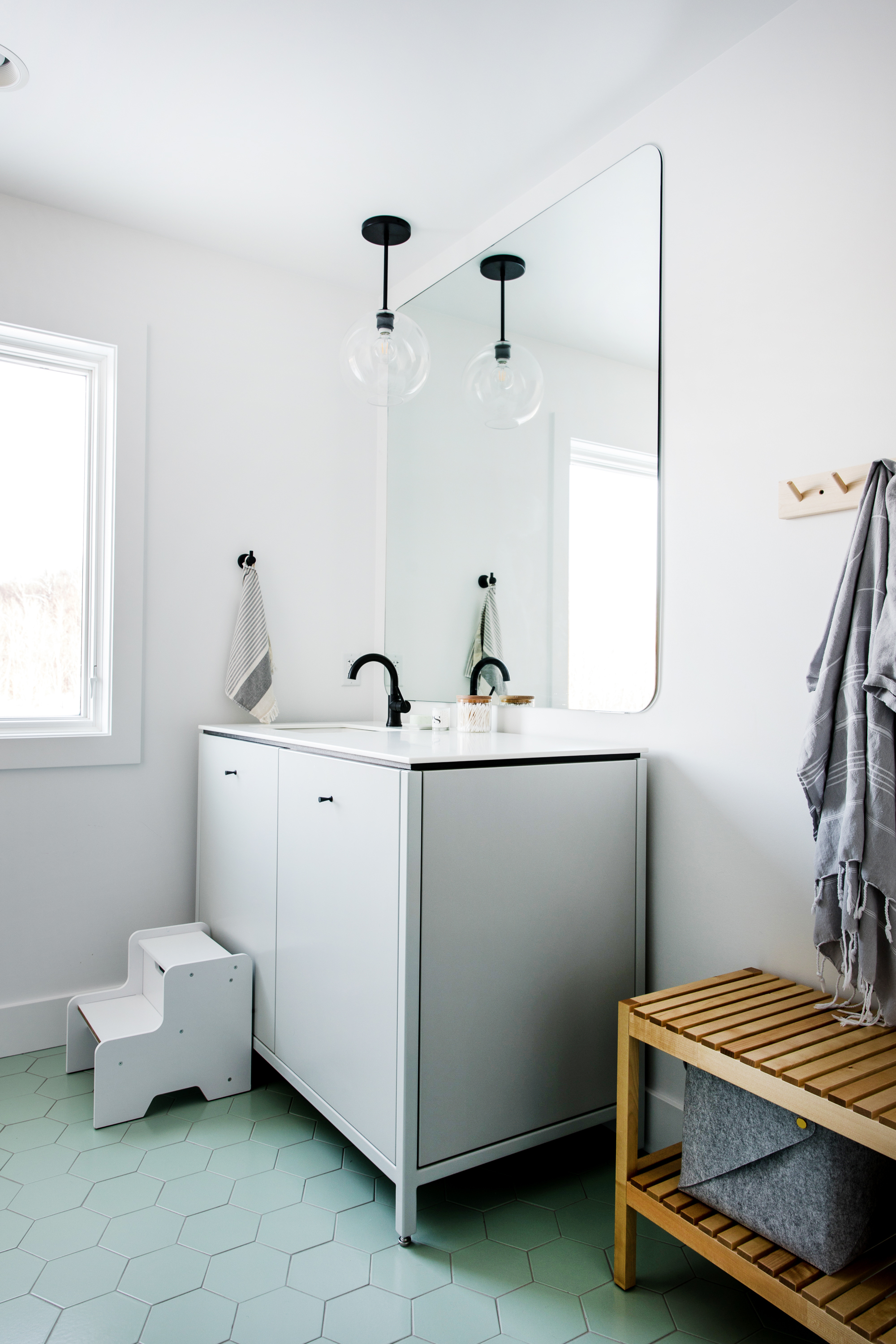 "This kid's bathroom features our 6"" Hexagon tiles in Sea Glass, one of our matte glazes."