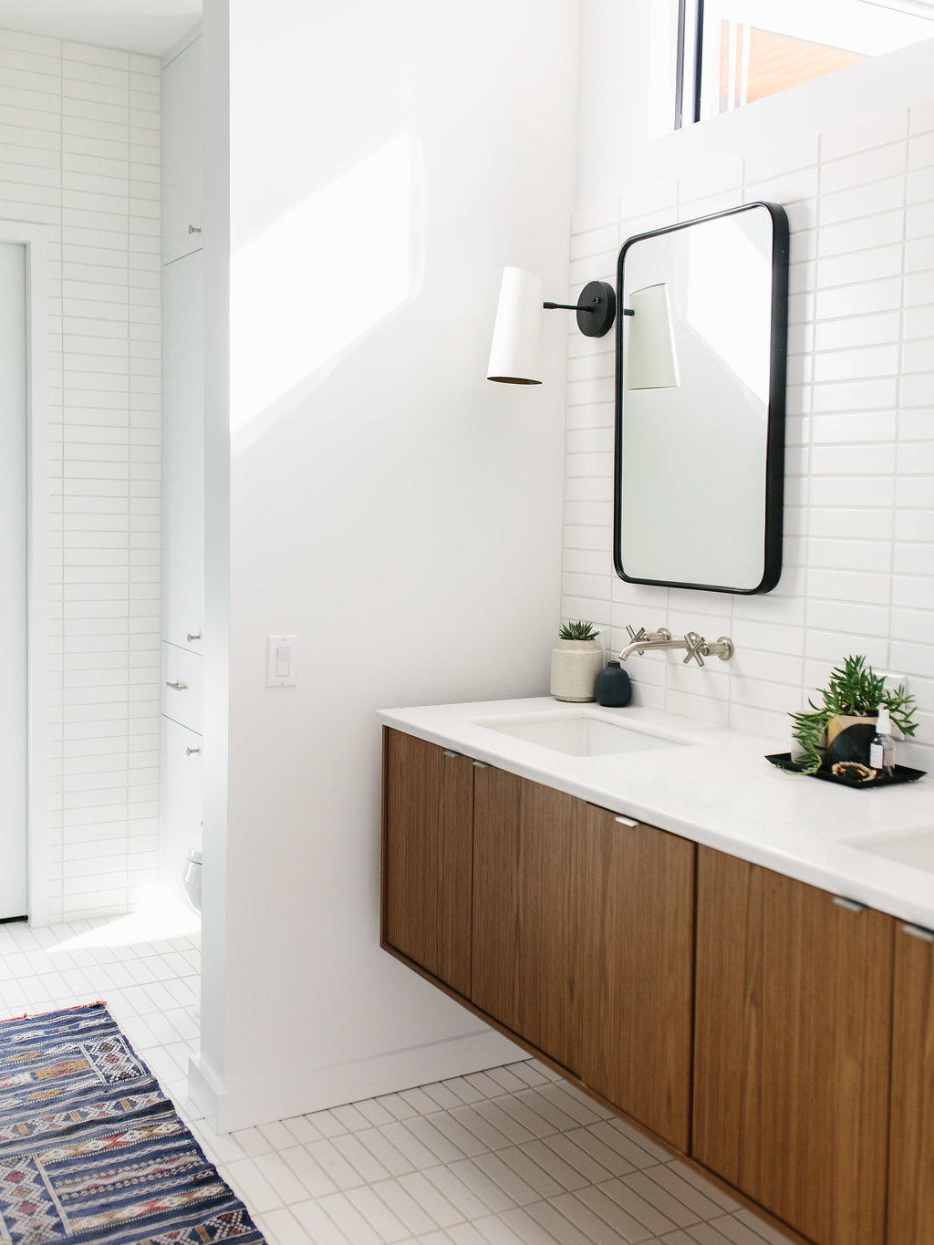 Jen Pinkston's bathroom features our 2x8 Tiles in Sugar