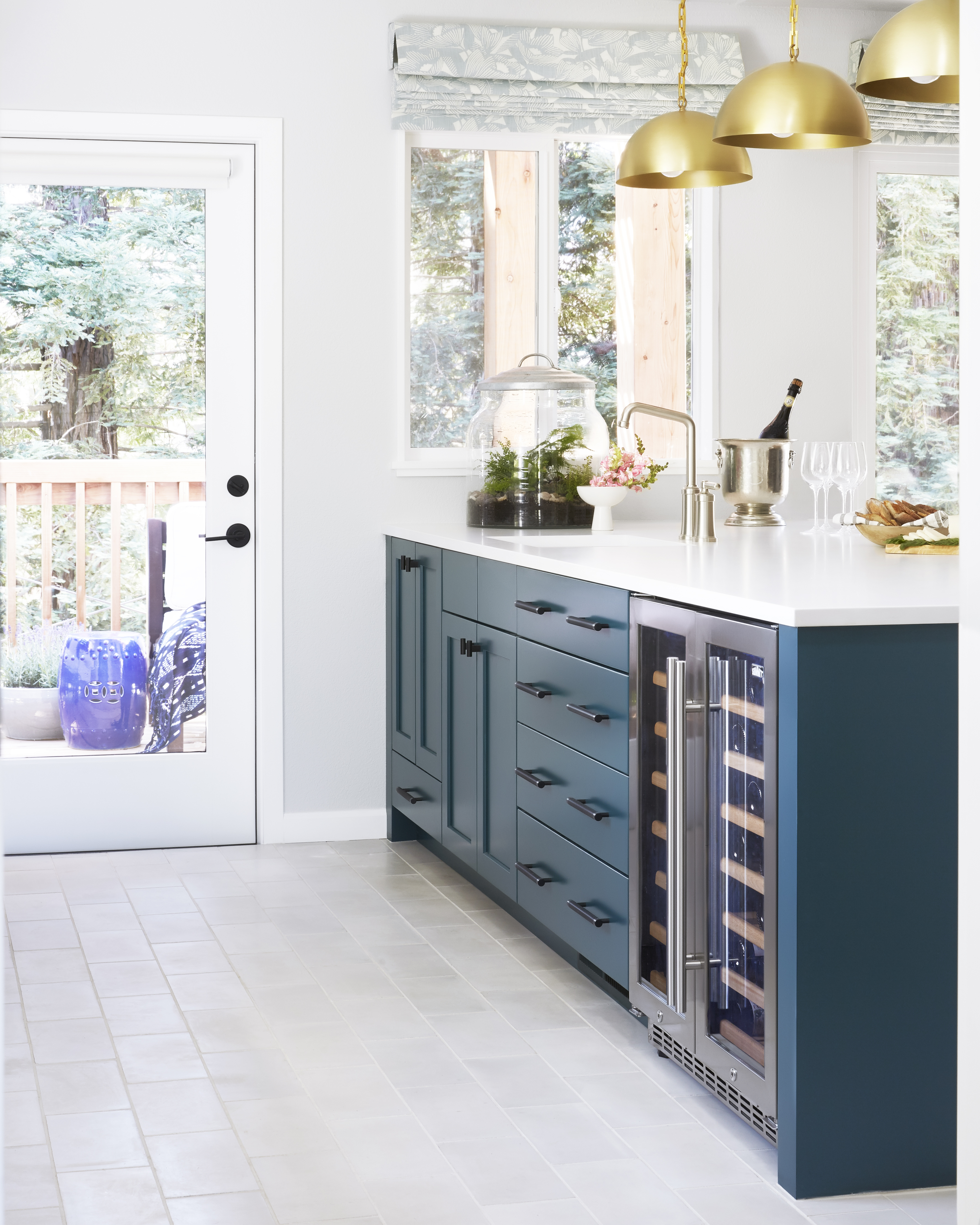 This peacock blue island perfectly compliments the other finishes in this stand out kitchen.