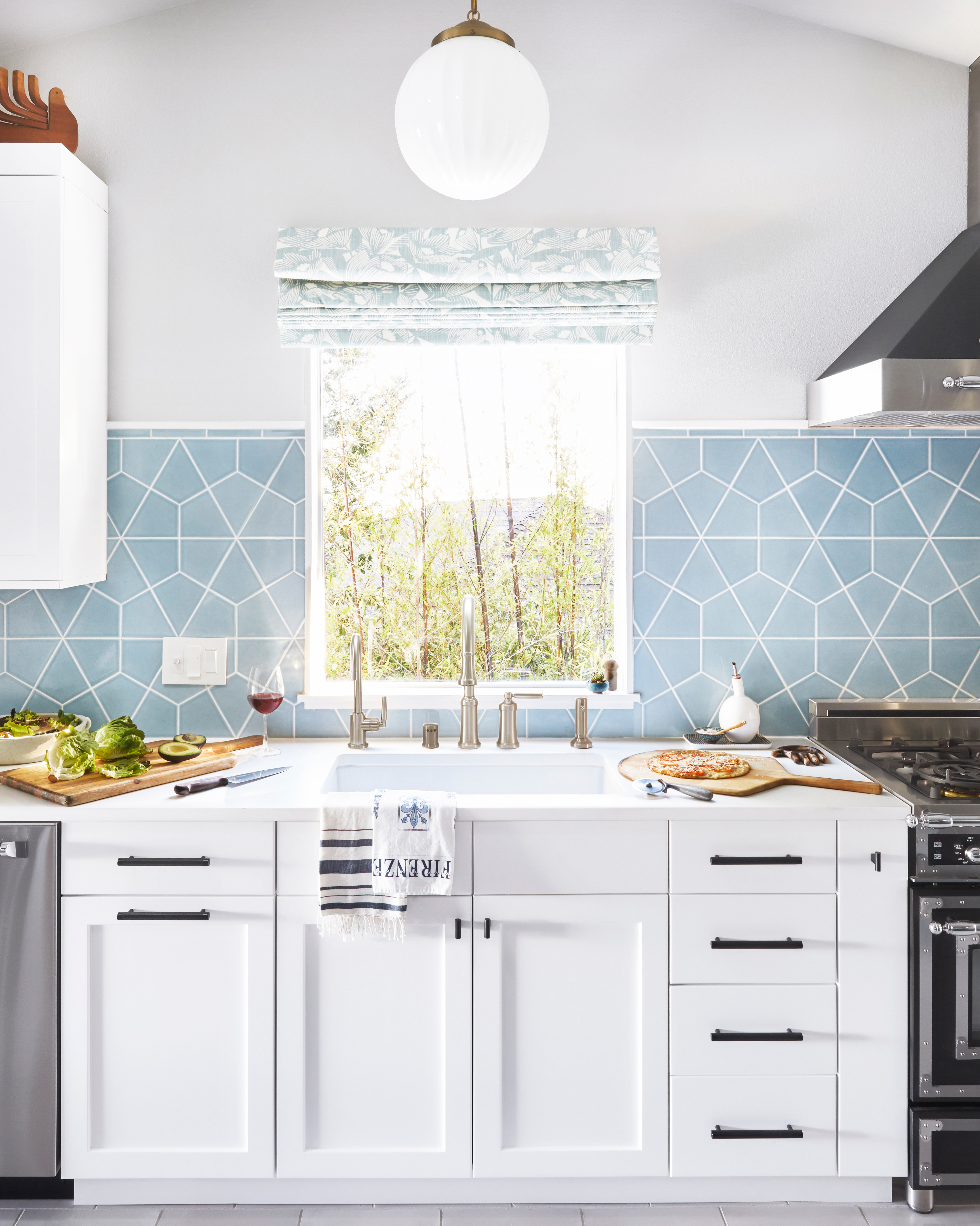 Orlando Soria's family kitchen reveal, featuring our Hexite tiles in Crater Lake.