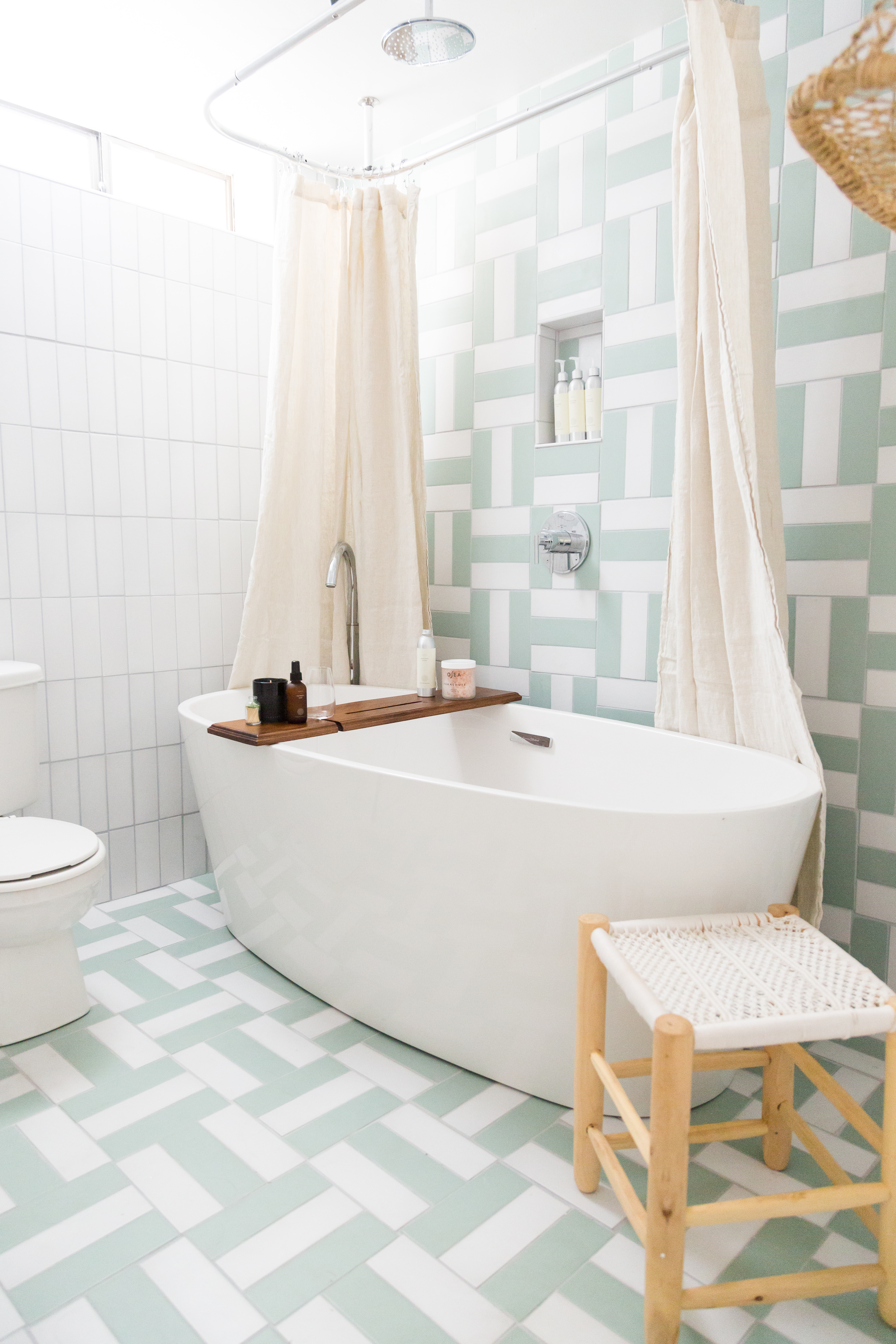 Claire Thomas took her own spin on a bold parquet pattern in both her cabin's bathrooms.