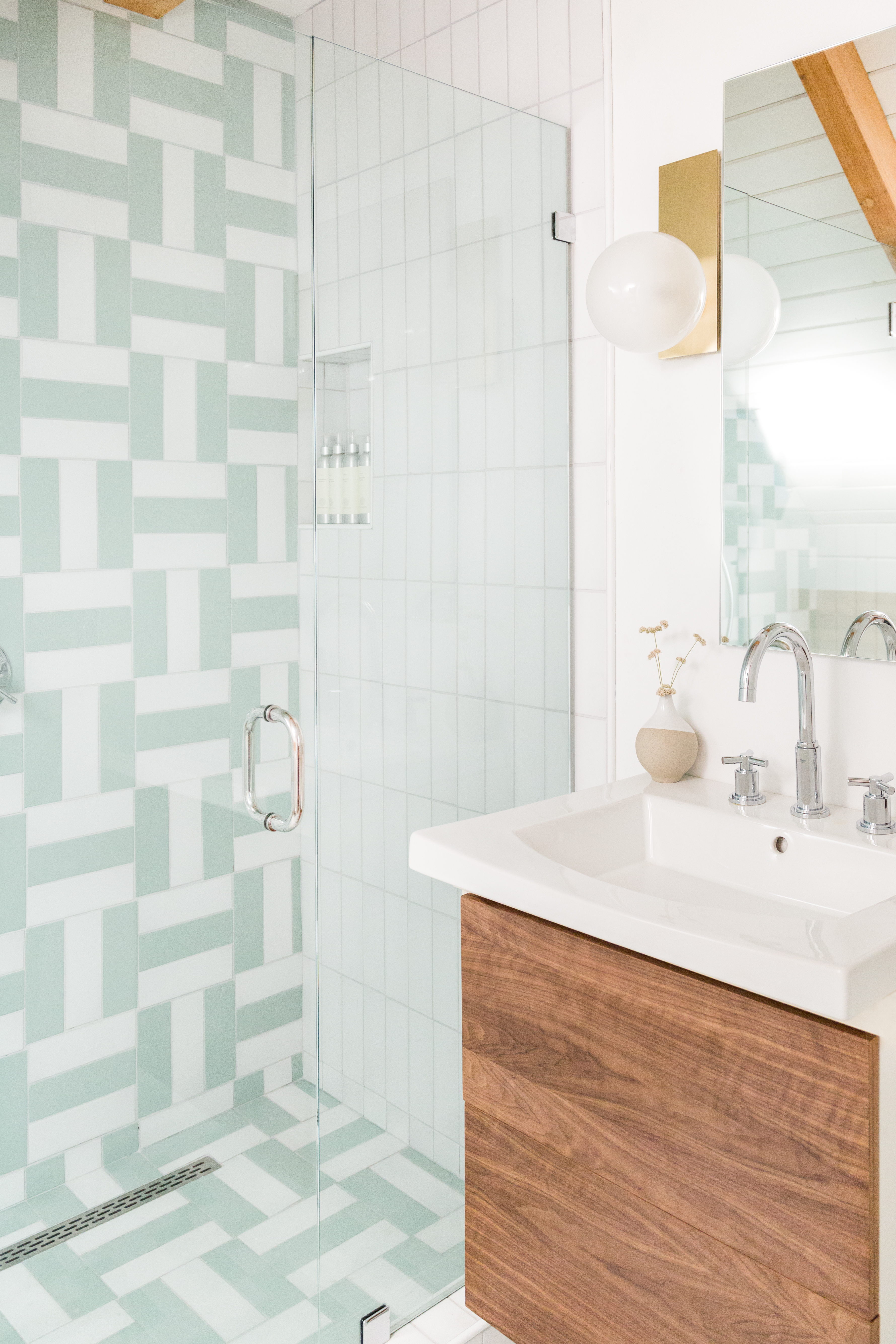 3x9 tiles set in a parquet pattern in Daisy and Sea Glass