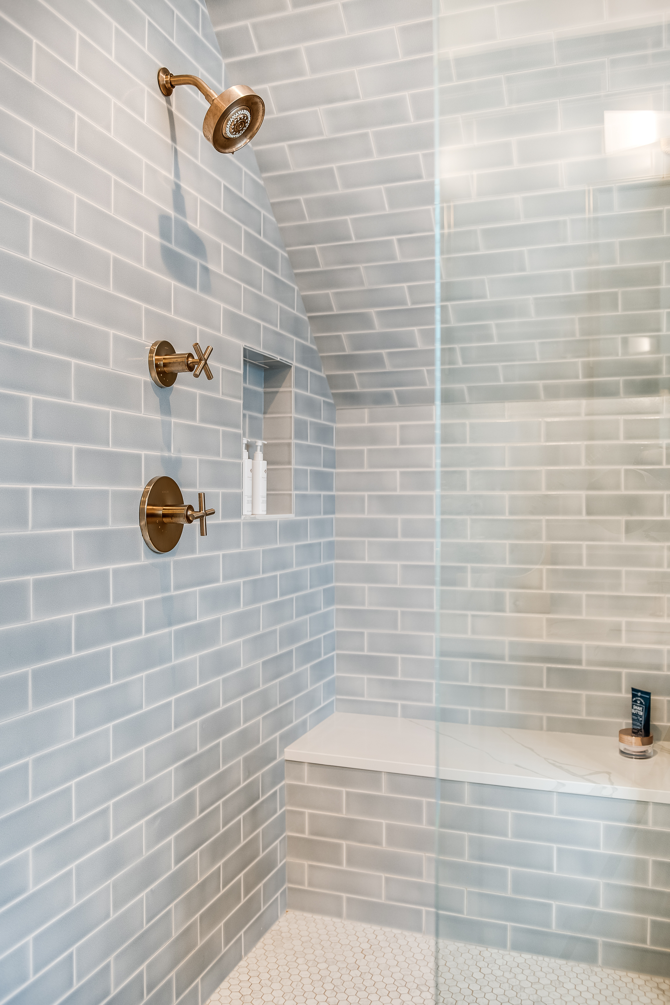 2018_img_q2_hi_res_RIGHTS_FIO_CREATIVE_PHOTO_cara_alyn_interiors_web_hi_resolution_bathroom_shower_surround_and-vanity_accent_wall_foggy_morning_ceramic_3x9_offset_glazed_edge_trim_SLANT_CEILING_FC217663_3.jpg?mtime=20190122165043#asset:433440