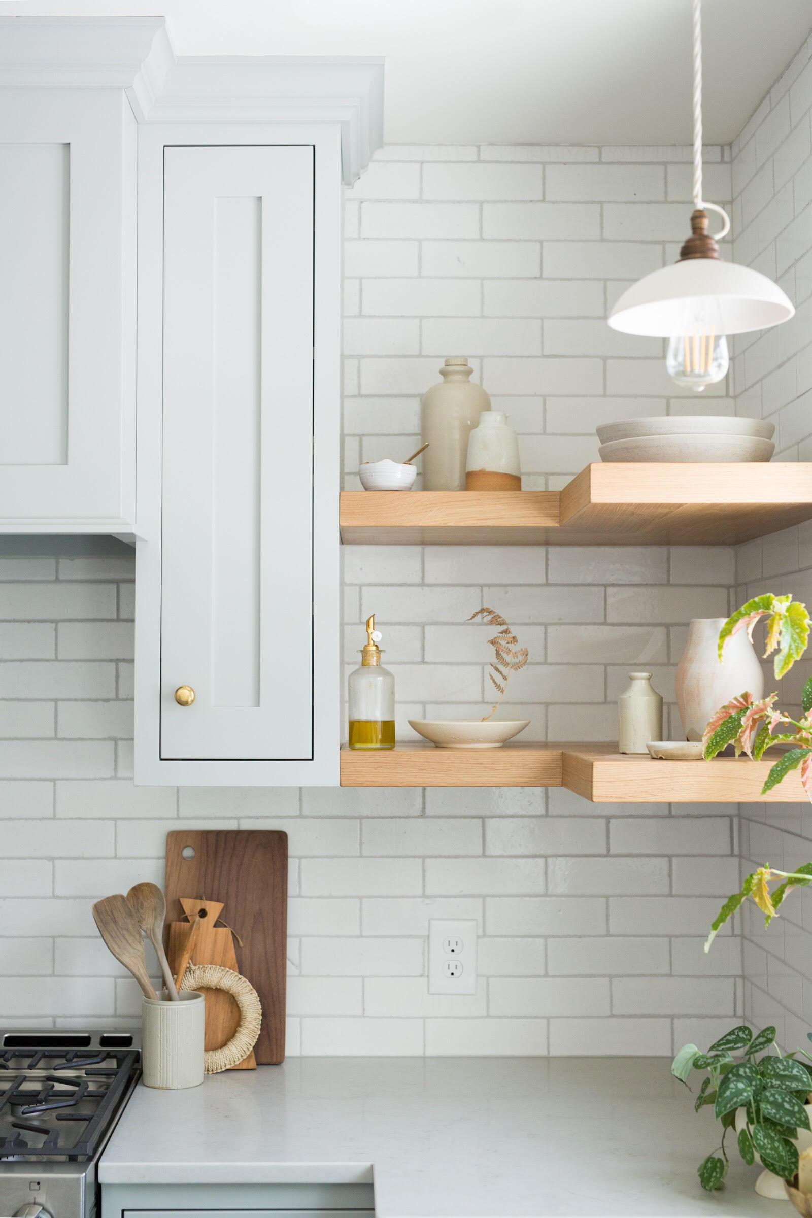 Traditional shaker cabinetry pair easily with our classic Glazed Thin Brick in Olympic.
