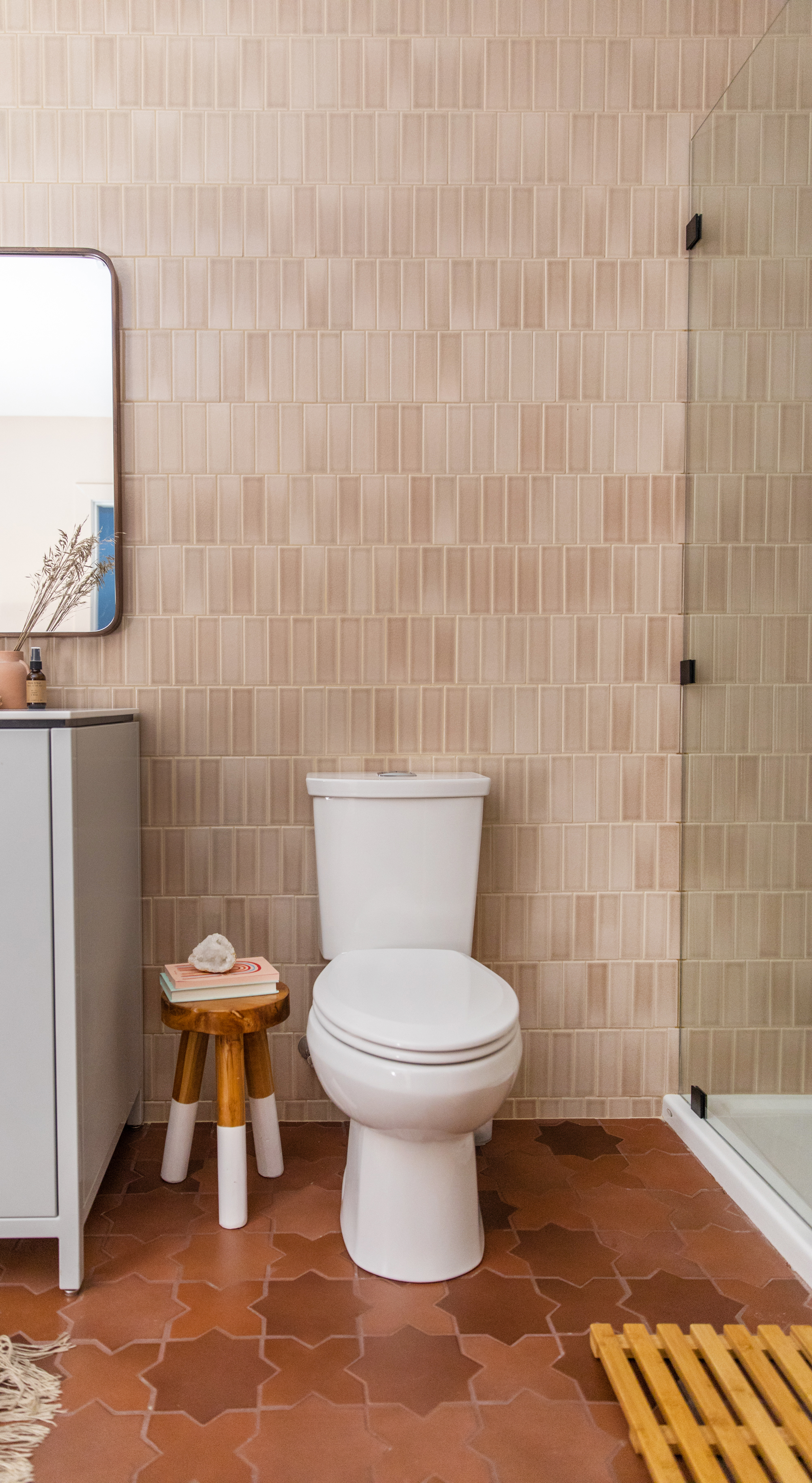 Floor to ceiling tile in this beautiful basement bath, featuring 2x6 tiles in Sand Dune and Large Star and Cross floor tiles in Antique