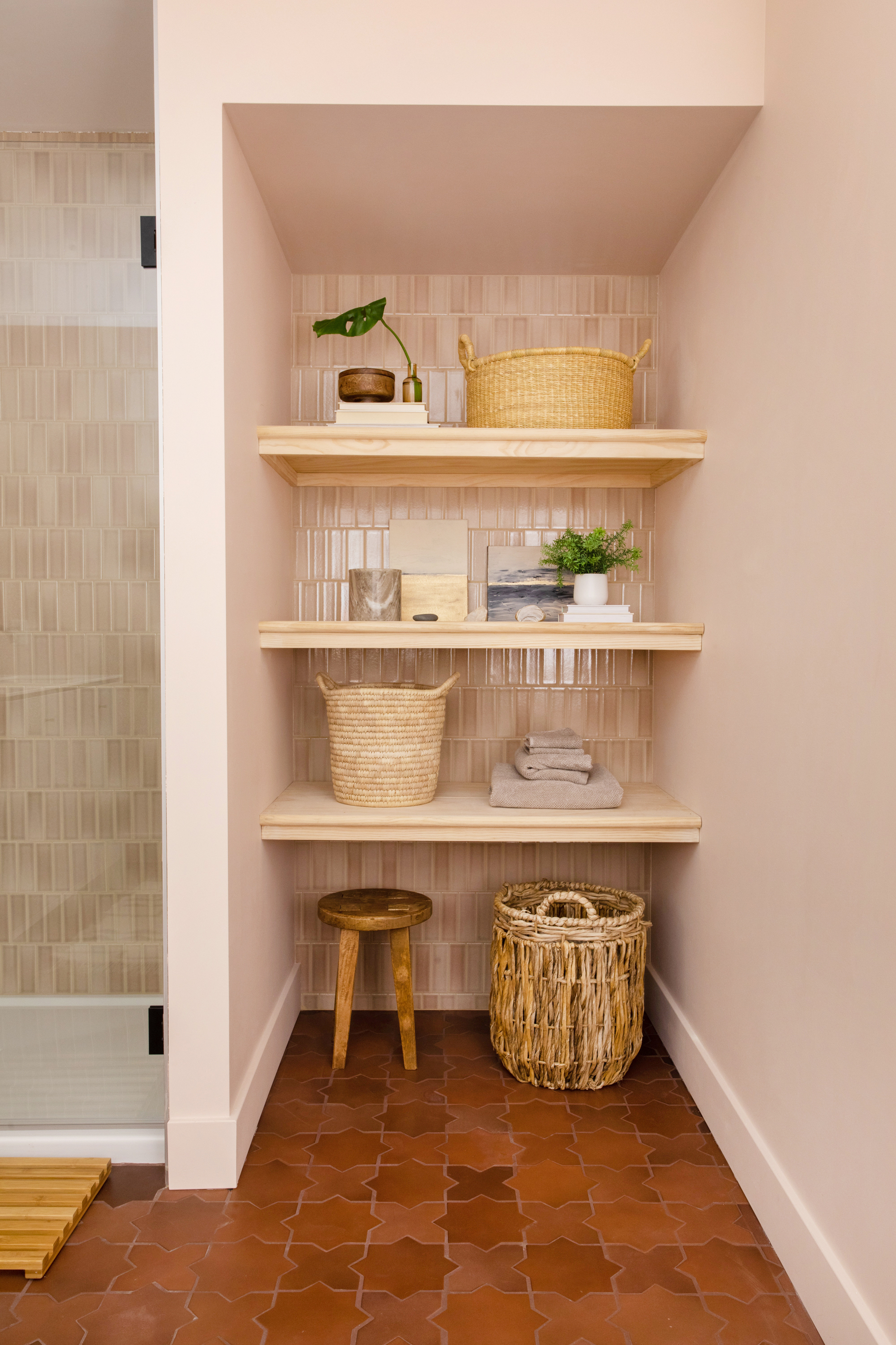 Sometimes more is better, especially when it comes to tile. Megan continued her wall tile into the open shelving into her basement bath. See more in our gallery!