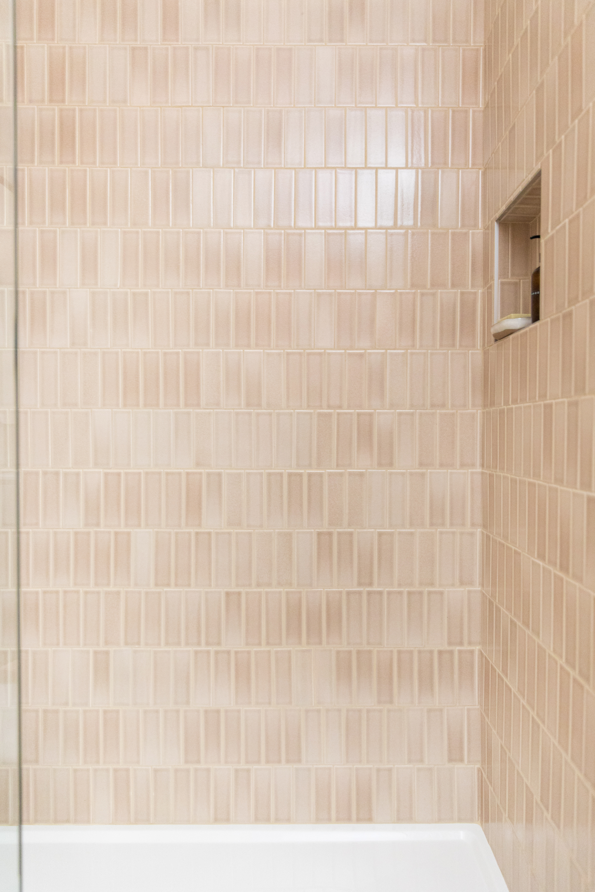 2x6 Sand Dune tiles cover these shower walls.