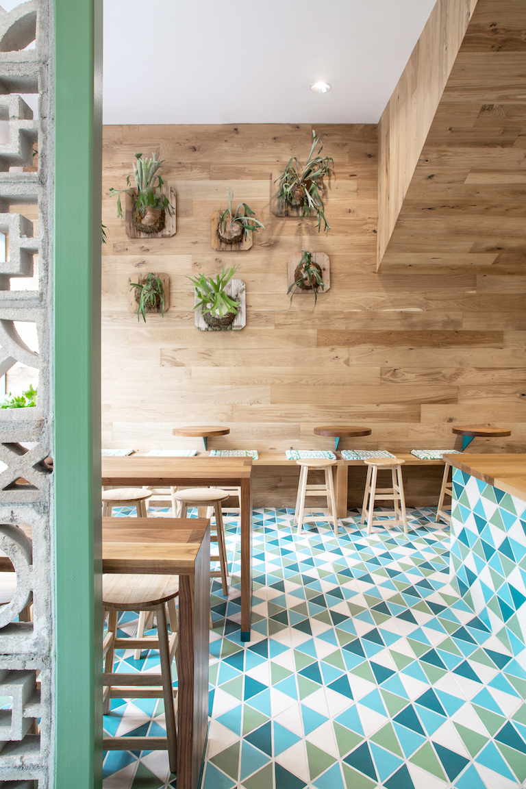 "6"" Triangles in a colorful blend make for fun underfoot at this restaurant."