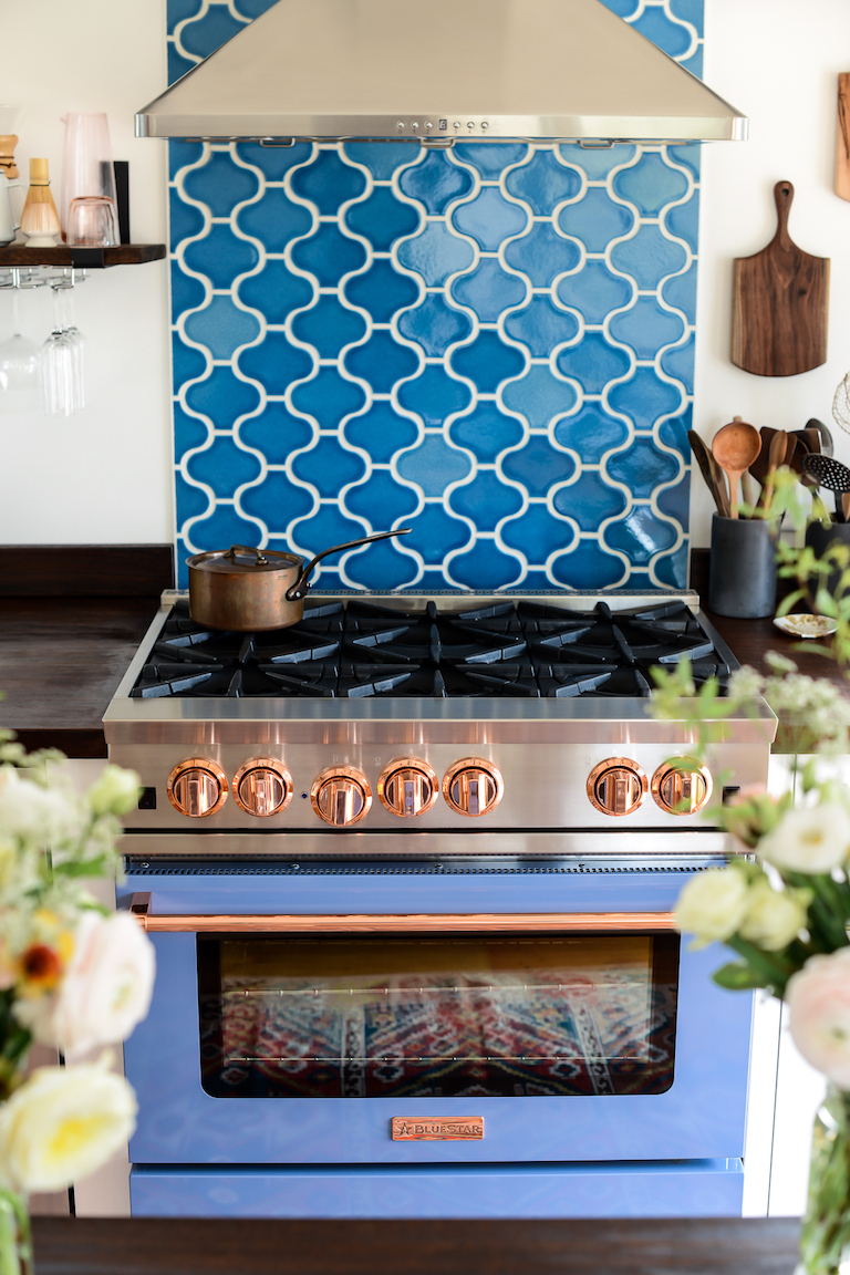 A little tile can go a long way, see how on this kitchen reveal.