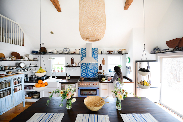 With food blogger and chef Kaity Farrell's eclectic curation of accents, appliances, and serveware on display, her airy Nantucket kitchen's main feature is a dreamy Aegean Sea backsplash in our sinuous Paseo pattern.