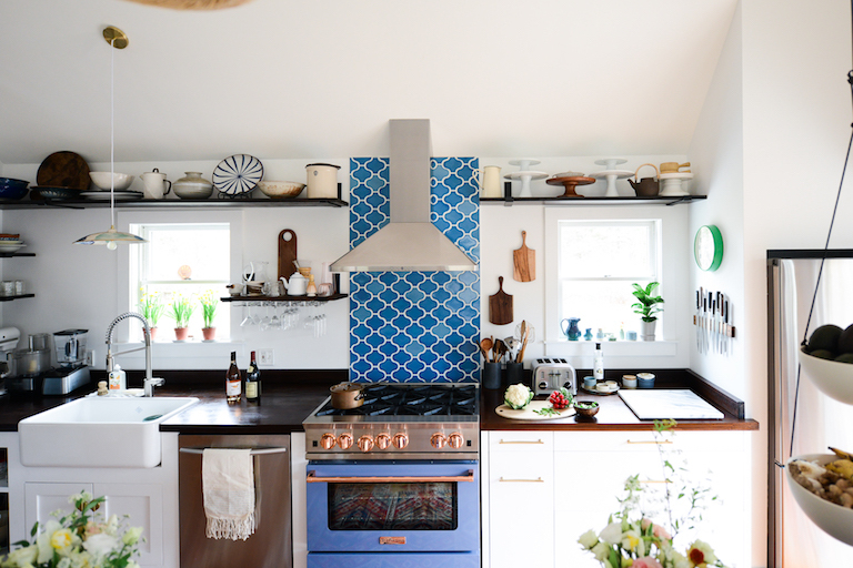 Paseo tiles in Aegean Sea make a splash in this charming kitchen.