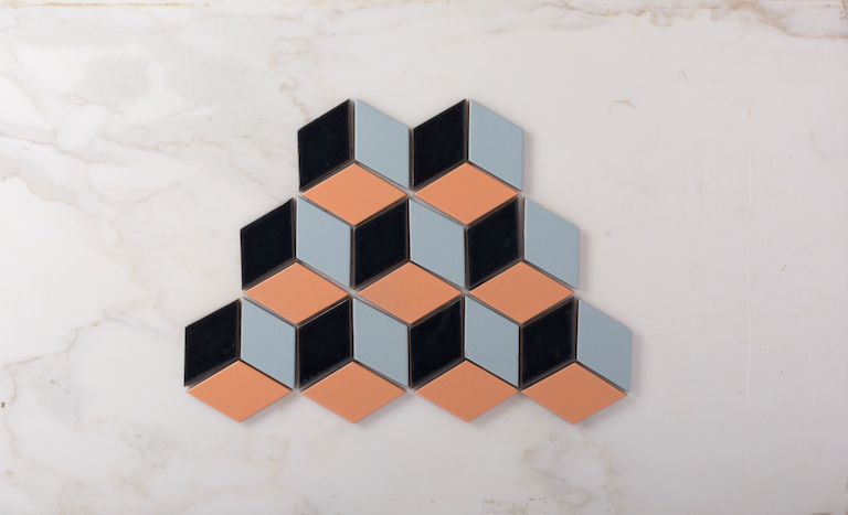 Small Diamonds in a blend of colors in an escher pattern.