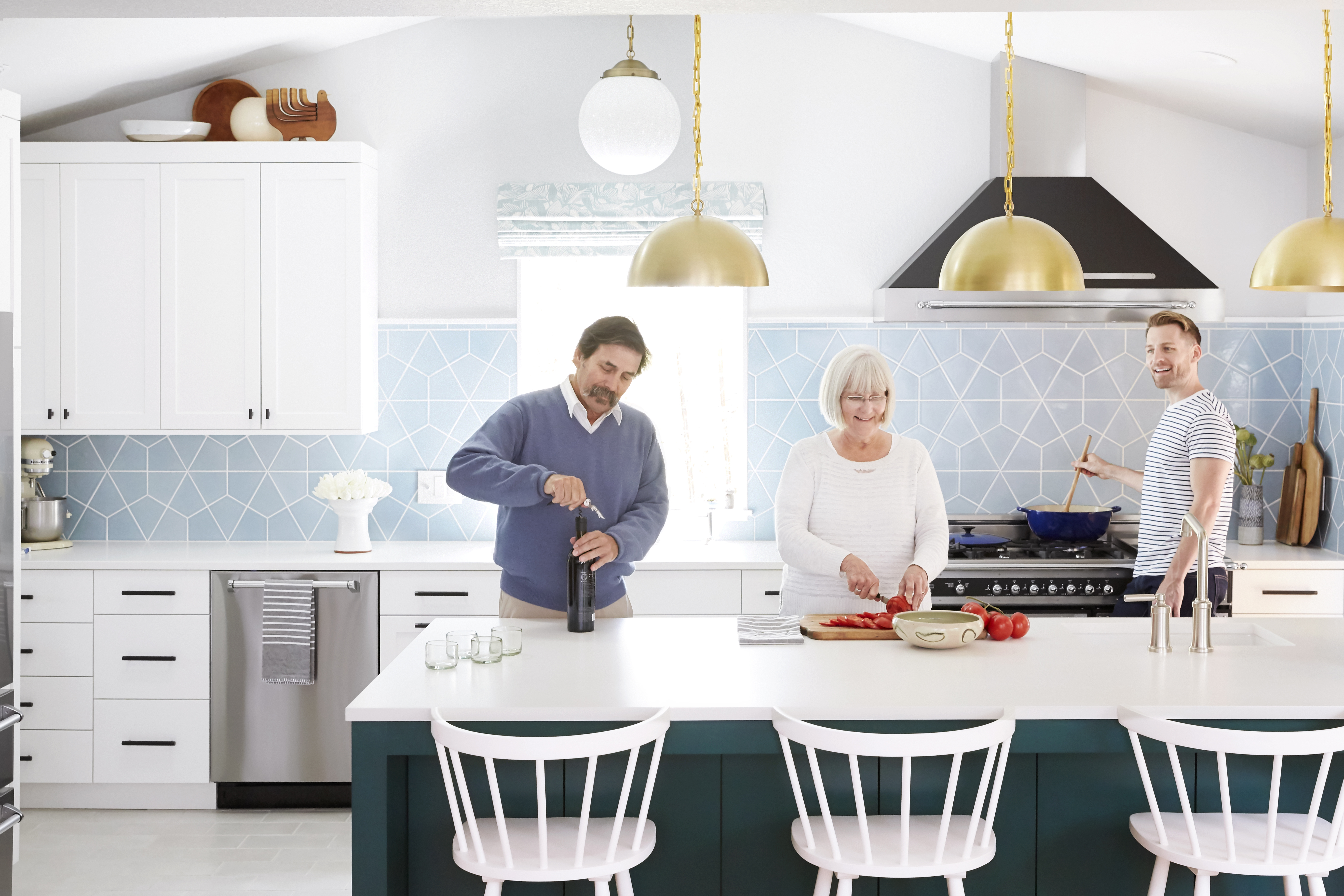 Orlando Soria and his parents in their new kitchen.