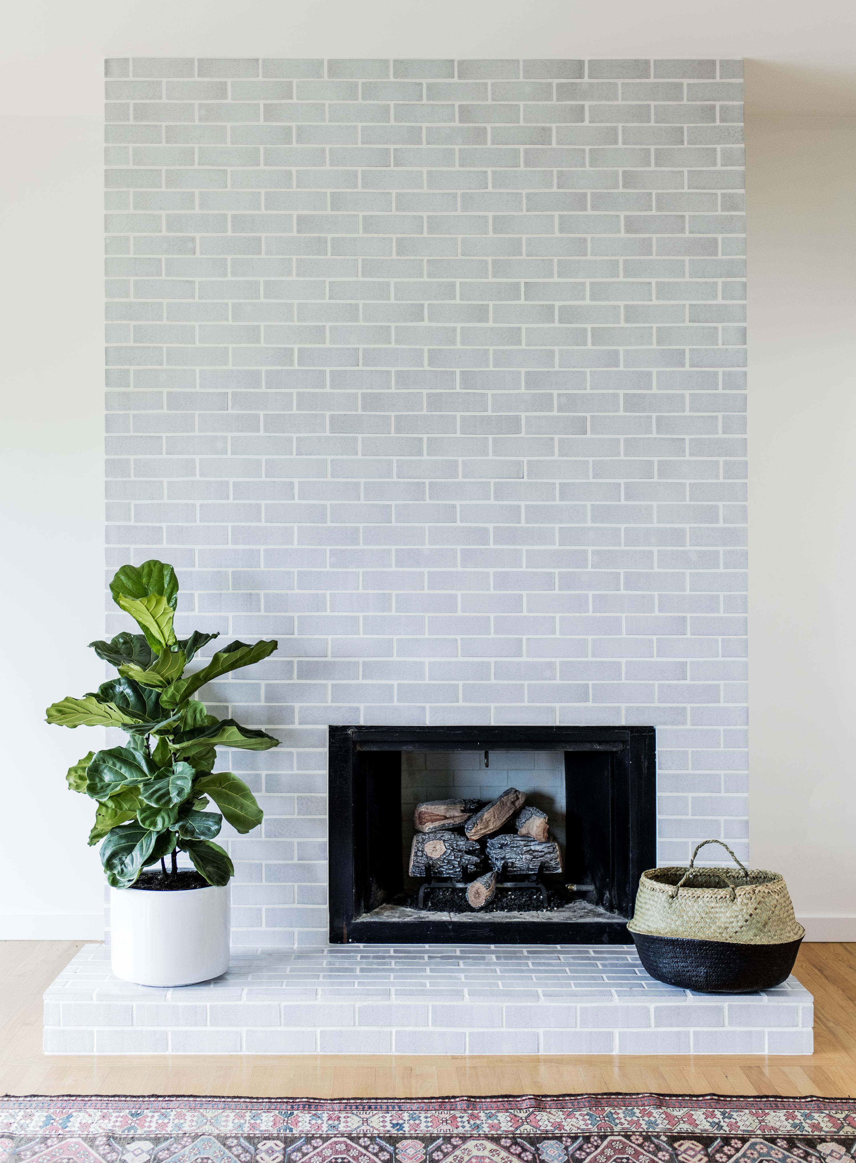Mid-century modern fireplace surround in Winter Mountains Glazed Thin Brick