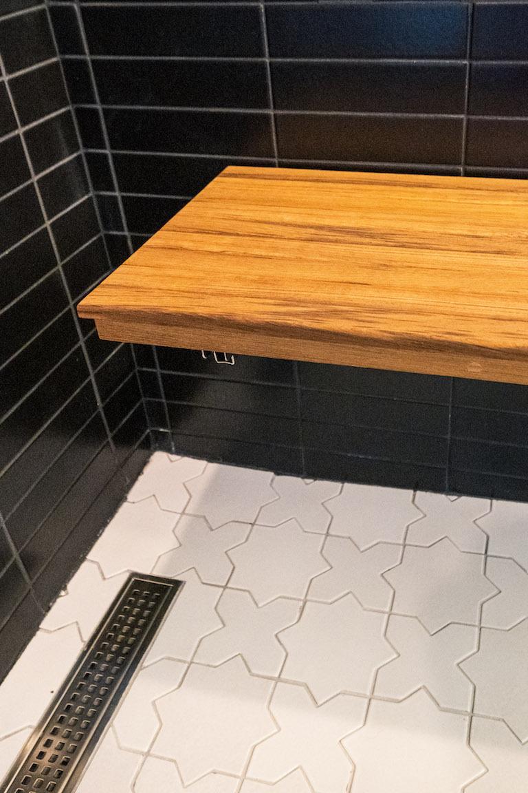 blog-2018_q4_hi_res_rights_FC239163_pam_matt_mcgrogan_ceramic_bathroom_master_shower_2x8_basalt_horizontal_straight_stack_ceiling_bullnose_trim_mini_star_cross_daisy_shower_pan_5.jpg?mtime=20190418164805#asset:448803
