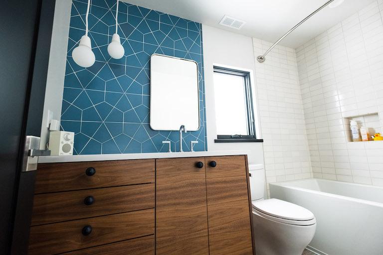 blog-2018_q4_hi_res_rights_FC239163_pam_matt_mcgrogan_ceramic_bathroom_vanity_wall_accent_dusty_blue_hexite_tusk_3x6_field_shower_surround_bullnose_trim_straight_stack_4.jpg?mtime=20190418164756#asset:448794
