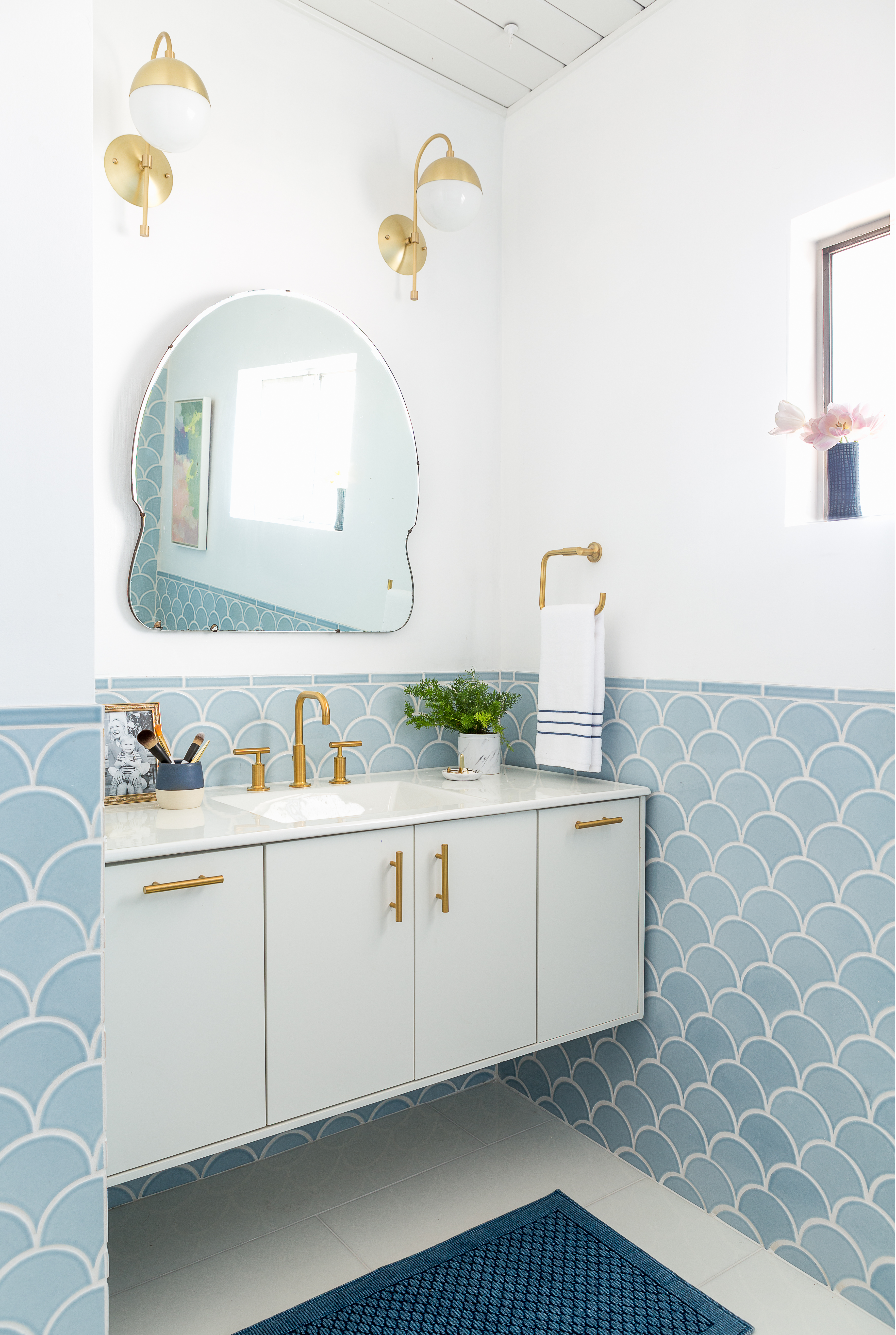 Emily Henderson's bathroom features our Ogee Drops in Crater Lake