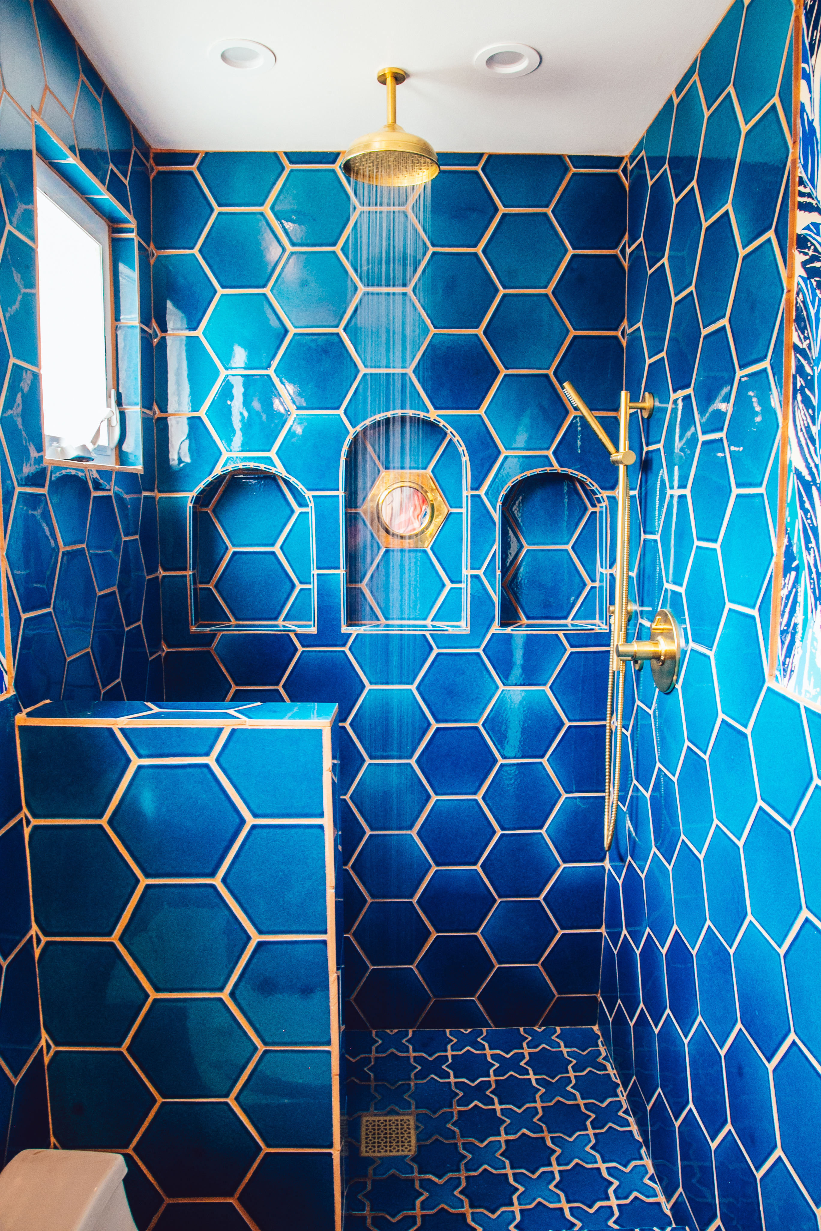 """Justina Blakeney's masterbath features our 8"""" Hexagons and Mini Star and Cross in Adriatic Sea."""