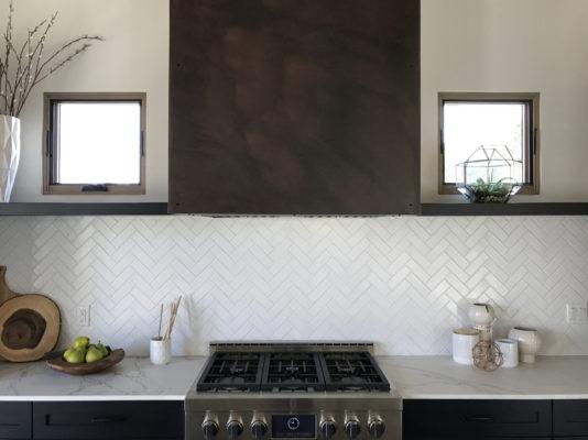 The Canal House: Herringbone Tile Backsplash