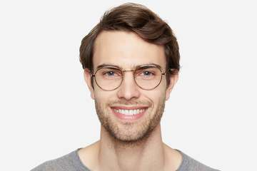 Hamilton eyeglasses in gold on male model viewed from front
