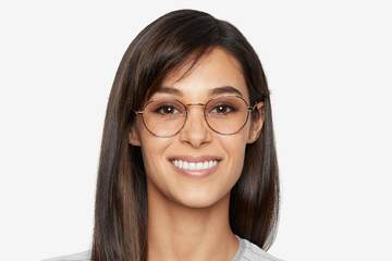 Hamilton eyeglasses in gold on female model viewed from front