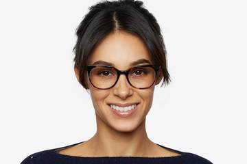Kelvin eyeglasses in whiskey tortoise on female model viewed from front
