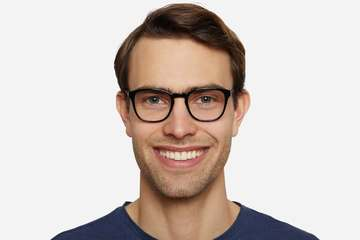 Tole eyeglasses in black on male model viewed from front