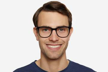 Volta eyeglasses in black on male model viewed from front