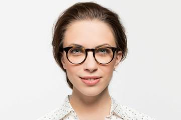 Turing eyeglasses in whiskey tortoise on female model viewed from front