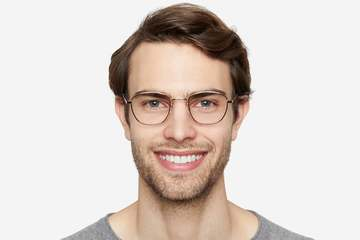 Haro eyeglasses in gold on male model viewed from front