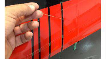 Knifeless Tape used under vinyl to cut stripes. Photo courtesy of Florida Car Wraps, floridacarwrap.com