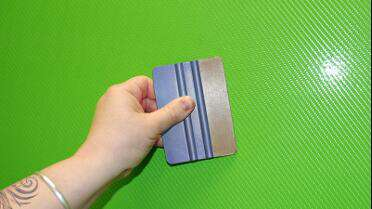3M 5151 Squeegee Tape on the edge of squeegee.