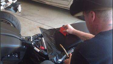 Frank using the Avery Pro Flex squeegee on his motorcycle.