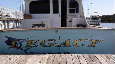 Orafol 383 Ultra Leaf Gold cut graphics on boat. Photo courtesy of Coastal Graphics 7, Hampton, VA.